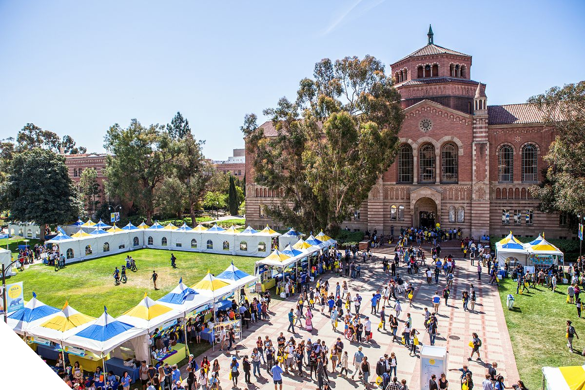 College students visiting outdoor information booths on a UCLA campus